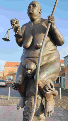 """Survival of the fattest"". Sculpture by Jens Galschiøts in Ringkoebing, Denmark."